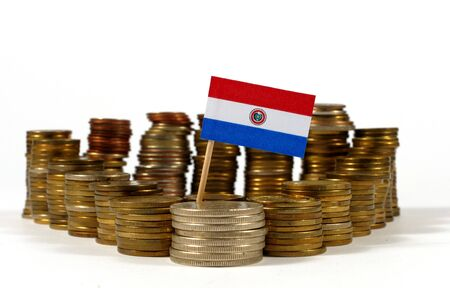 Paraguay flag waving with stack of money coins Stock Photo
