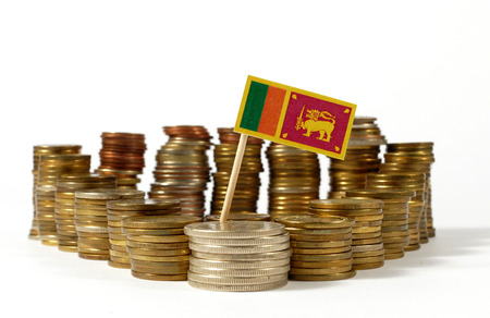 Sri Lanka flag waving with stack of money coins Stock Photo
