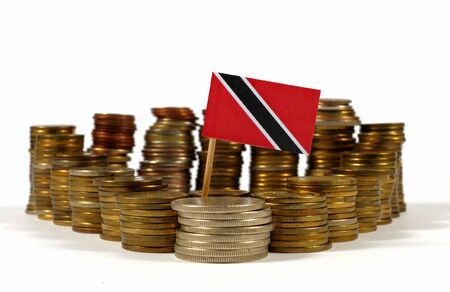 Trinidad and Tobago flag waving with stack of money coins Stock Photo