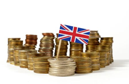 Great Britain flag waving with stack of money coins