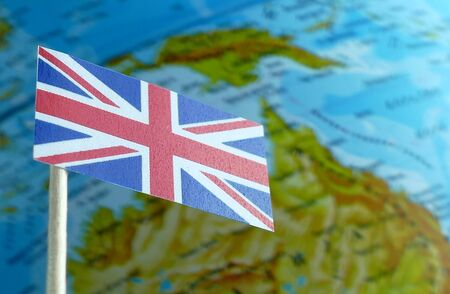 Great Britain flag with a globe map as a background macro