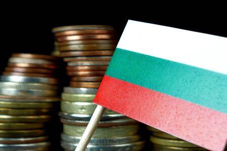 Bulgarian flag waving with stack of money coins macro Фото со стока