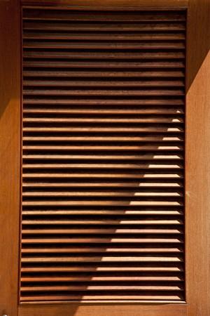 wood jalousie door texture  with lighting photo