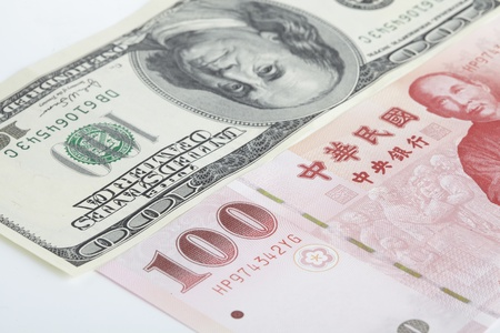 one piece of one hundred dollar of  New Taiwan Dollar cash and one piece of twenty  dollars of US case with white backuground close up photo