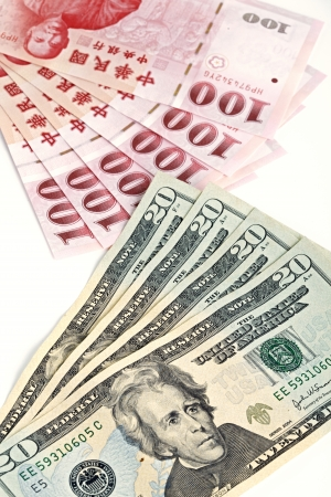 six piece of one hundred dollar of  New Taiwan Dollar cash and five piece of twenty  dollars of US case with white backuground close up photo