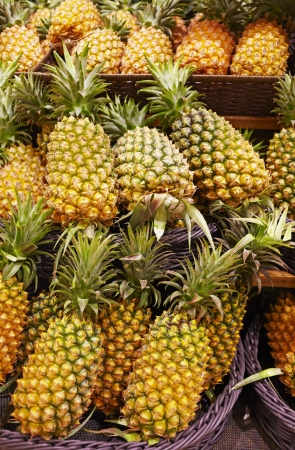 many pineapples put in bracket,in market Stock Photo - 14912828