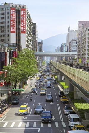 Taipei City, Taiwan, 2012, July,12th :  Taipei Metro Brown Line Train Elevated Rail with Street Sight view