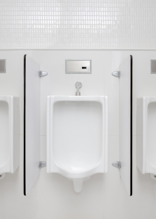 urinal: urinal in restroom front view