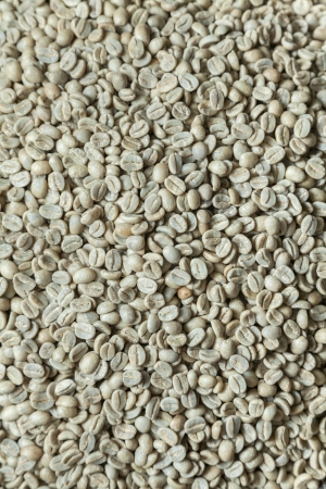 unroasted: unroasted coffee beans close up top view Stock Photo