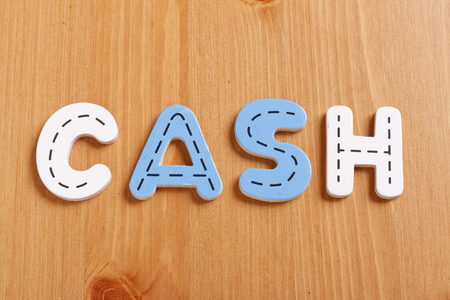 latter: CASH, spell by woody puzzle letters with woody background