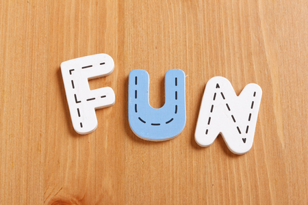 latter: FUN, spell by woody puzzle letters with woody background