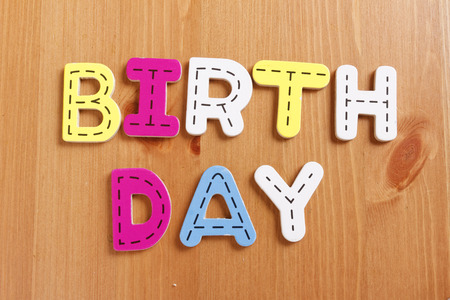 spell: BIRTHDAY, spell by woody puzzle letters with woody background