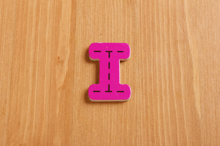 spell: I, spell by woody puzzle letters with woody background