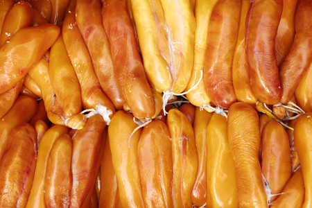 grey mullet: drying grey mullet roe on boards with sunlight Stock Photo