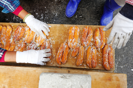 grey mullet: worker does salting and drying grey mullet roe