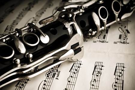 classical music:  Clarinet on a sheet of music notes