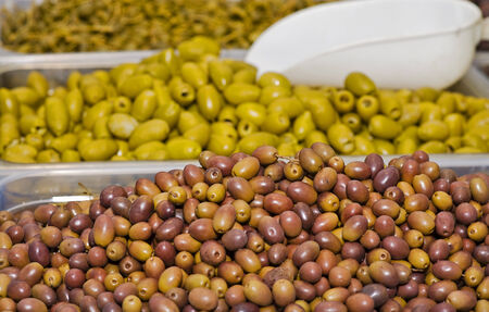 gutted: olives gutted on a market stall  Stock Photo