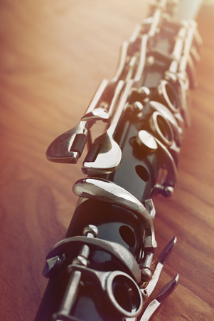 clarinet: A clarinet on a wooden base Stock Photo