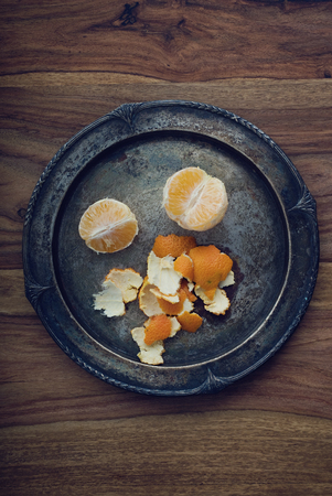 close p: A silver plate with a tangerine Stock Photo
