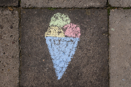 childs: A childs chalk drawing with an ice cream cone as motive