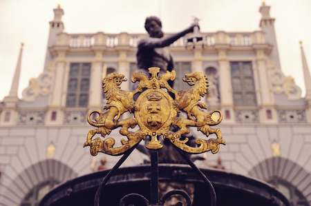 city coat of arms: The Neptune fountain with city coat of arms in front of the Artus Court in the city of Gdansk