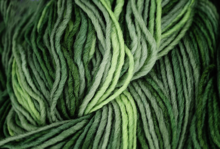 descriptive color: Green wool yarn with an interesting structure Stock Photo