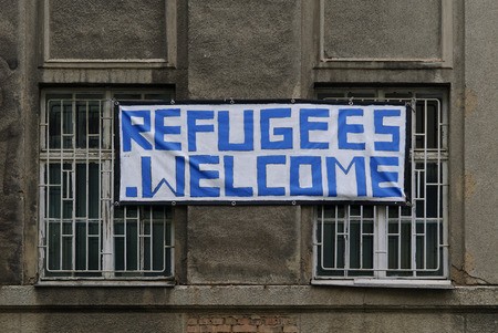 homeowners: Helpful homeowners in Germany mark their house from the outside as a refugee accommodation