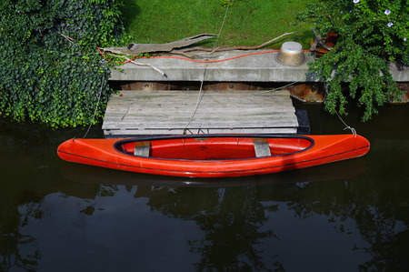 recreational pursuits: a canoe is on a Landing stage Stock Photo
