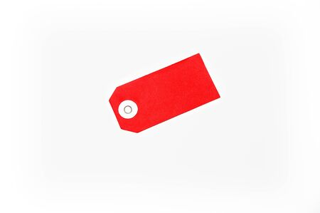 descriptive color: A red label of paper against a white background Stock Photo