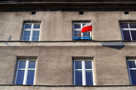 nationalism: a Polish flag on a simple House in Poland as a sign of patriotism