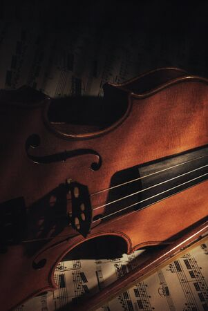 bluegrass: detail of an old violin with note sheet Stock Photo