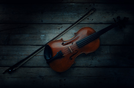 antique table: old antique Violin on wooden table