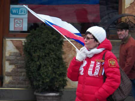 annexation: The woman at the party holding the flag Russia