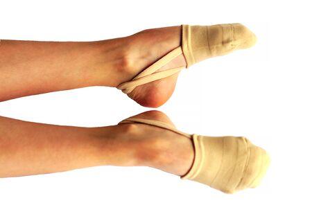 Rhythmic gymnastics shoes worn on white background.
