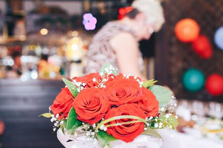 formal dinner party: Wedding table decor with red flowers and plates
