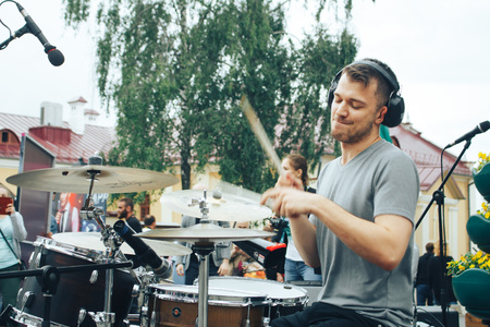 MINSK, BELARUS.JULY 29 2017 A street muscian playing drums