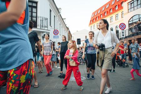 MINSK, BELARUS.August 5, 2017 Group of people sporting dancing outdoors Editorial