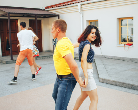 MINSK, BELARUS.August 12, 2017 Couples dancing outdoors on the street Stock Photo - 86463813