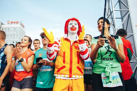 MINSK, BELARUS.September 10 2017 Half Marathon The girl and the clown shoot themselves on the phone