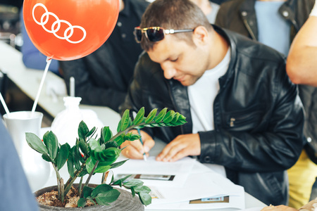 MINSK, BELARUS.August 26, 2017. Test drive audi. A group of people fill out the documents