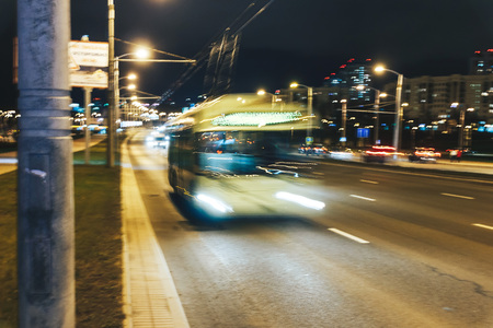 The trolleybus is on the road. Long exposure. Blurred background Stock Photo