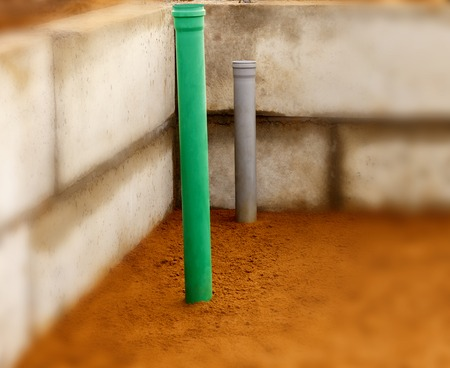 Sewer pipes in home basement. Stock Photo