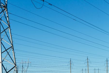 Power transmission line on high voltage post.