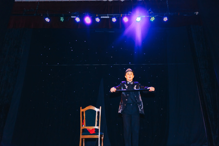MINSK, BELARUS November 4 2017 International Illusion Festival MAGIC 2017 Young magician shows the performance on stage