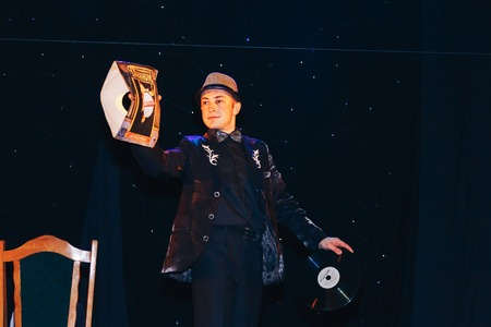 MINSK, BELARUS November 4 2017 International Illusion Festival MAGIC 2017 Young magician shows a performance with a big plate Editorial