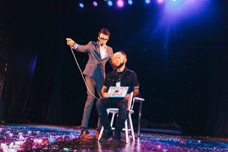 MINSK, BELARUS November 4 2017 International Illusion Festival MAGIC 2017 A young magician with an assistant shows the performance on stage