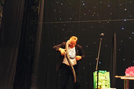 MINSK, BELARUS November 4 2017 International Illusion Festival MAGIC 2017 A man on stage shows objects for tricks snake