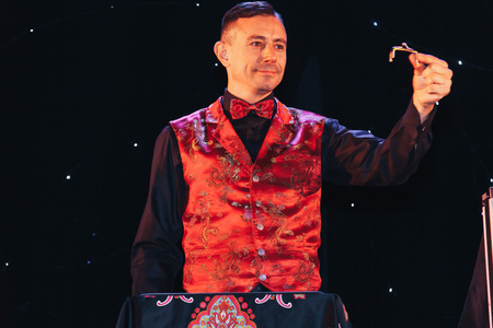 MINSK, BELARUS November 5 2017 International Illusion Festival MAGIC 2017 The male magician shows the performance on stage Editorial