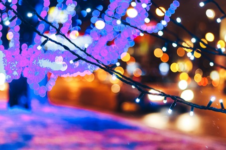 New year garlands near the road Blurred background Stock Photo