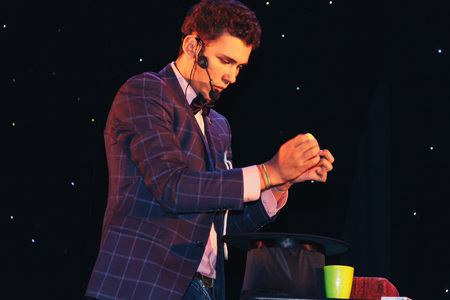 MINSK, BELARUS November 5 2017 International Illusion Festival MAGIC 2017 A young magician shows the performance on stage